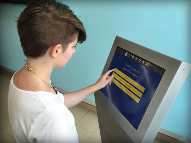 Anna Gibbons, an undergraduate public health major and member of the Drexel student organization Active Minds, which focuses on promoting mental health and wellness, demonstrates use of the mental health screening kiosk.