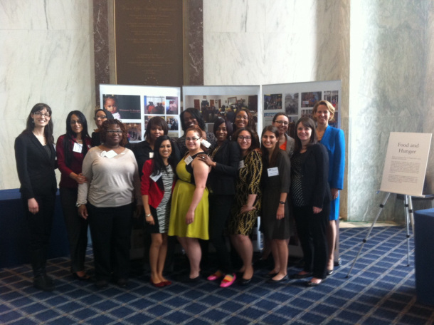 Members of Witnesses to Hunger, seen here during an exhibit of their photos on Capitol Hill in 2014 together with staff from Drexel's Center for Hunger-Free Communities in the School of Public Health and the center's director and public health associate professor, Mariana Chilton, at right.